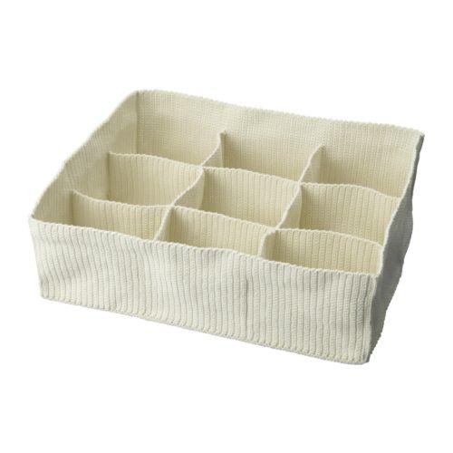 Caixa de pano com compartimentos.